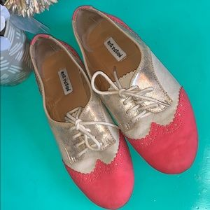 Coral and gold shoes